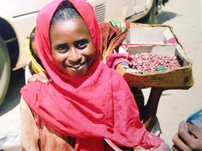 Meeting a girl who was selling peanuts to buy school supplies.