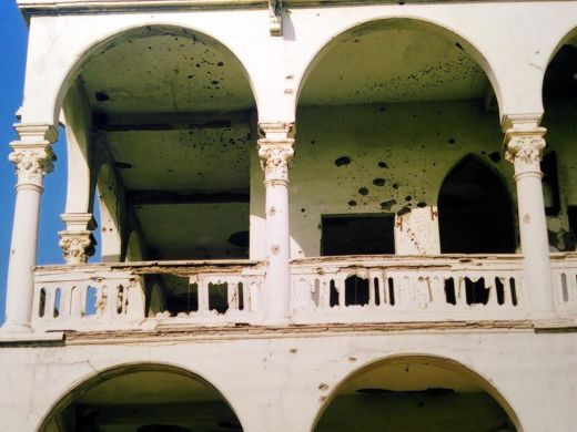 Bullet-ridden walls in Massawa, the coastal city that was bombed by the Ethiopian army. This was taken in 2004, over a decade after the damage had been done, and Eritrea had not yet repaired these buildings.