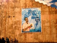 A mural in Asmara, the country's capital, depicting a man voting as those who died for the country's independence look on.