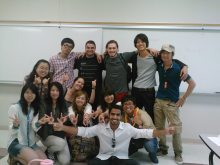 international students in a classroom, smiling in a group photo